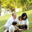 Happy family in the park — Stock Photo #12141685