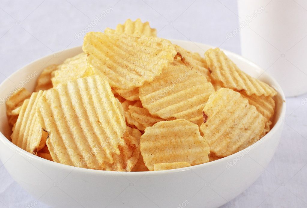 A pile of ruffled potato chips isolated on a white background  Stock Photo #12141624