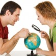 Couple looking at globe — Stock Photo