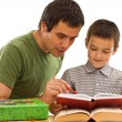 Schoolboy and his father learning — Stockfoto