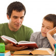 Schoolboy sleeping while his father reading — Stock Photo