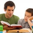 Stock Photo: Schoolboy sleeping while his father reading