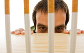 Man peeping from behind the table — Stock Photo