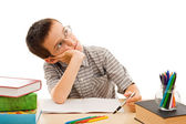 Schoolboy doing his homework — Stock Photo