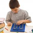 Schoolboy with calculator — Stock Photo