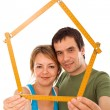 Couple with model house — Stockfoto
