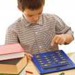 schooljongen met calculator — Stockfoto