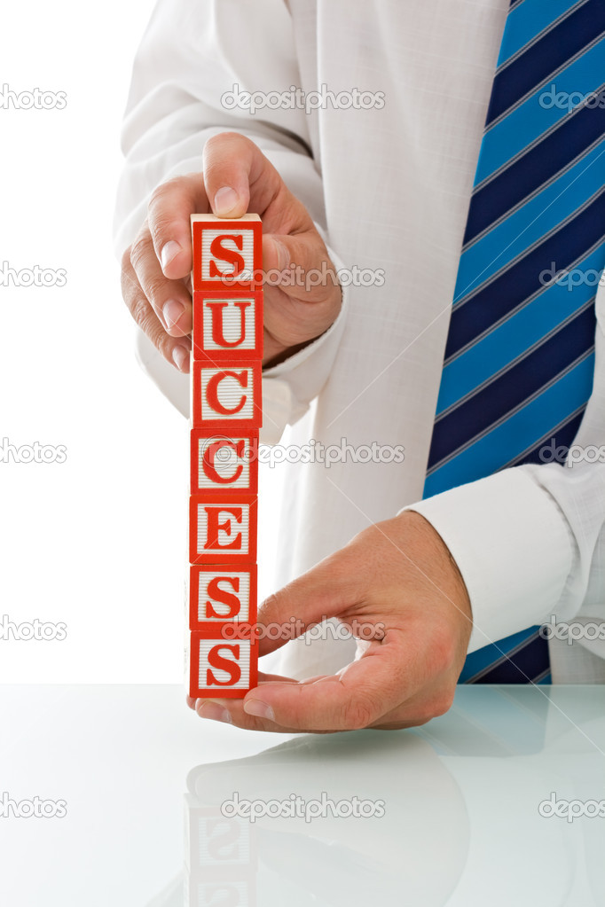 Businessman holding the SUCCESS sign - isolated — Stock Photo #10861374