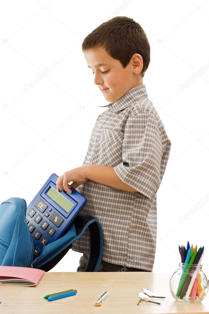 Schoolboy putting a calculator in a blue color schoolbag - isolated — Foto Stock #10861616