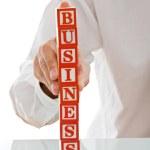 ブロックを持ったビジネスマン — ストック写真