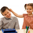 Little girl holding the boy by the ear — Stock Photo
