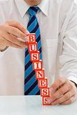 Businessman with blocks — Stock Photo