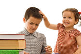 Little girl stroking the boy's head — Stock Photo