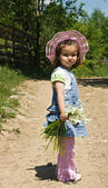 Little girl on the country lane — Stock Photo
