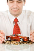 Businessman with red toy car — Stock Photo