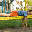 Stock Photo: Boy on the seesaw