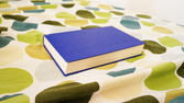 Blue book on the bed — Stockfoto