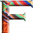 Letter F made with hand made woolen fabric — Stock Photo