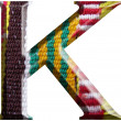 Letter K made with hand made woolen fabric — Stock Photo