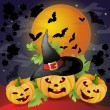 Halloween background with pumpkins — Stock Vector #12246788