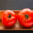 Two tomatoes — Stock Photo #10777796