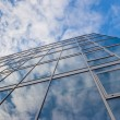 Building with clouds reflection — Stock Photo