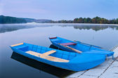 Two blue boats on lake — Stock Photo