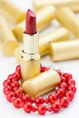 Red lipstick and jewelry — Stock Photo
