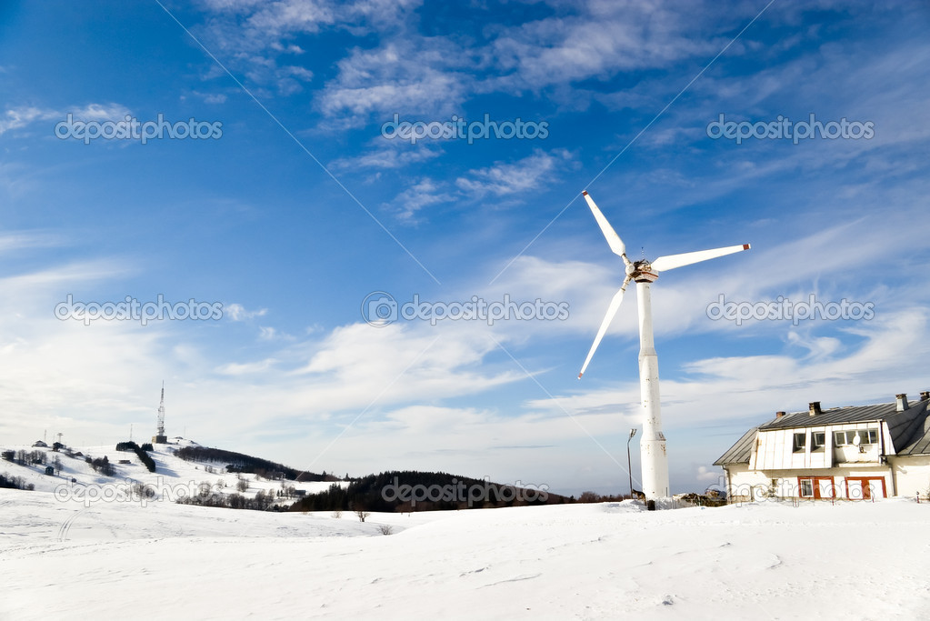 Wind turbine on mountain winter landscape — Stock Photo #11405460