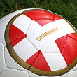 Royalty-Free Stock Photo: Football with danish flag on footballfield. HDR photo