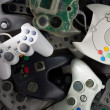 Stock Photo: Scattered Videogames Gamepads