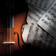 Stock Photo: Violin on Music Sheets