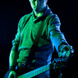 Stock Photo: Tuning Bass Guitar