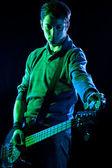 Tuning a Bass Guitar — Stock Photo