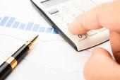 Businessman analysis of quotes — Stock Photo