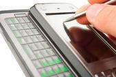 Smartphone in een hand — Stockfoto