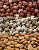Different nuts (almonds, cashews, and filbers) close up — Stockfoto