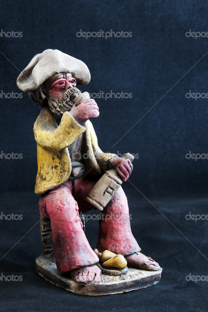 Old drunkard on a black background — Photo #11039436