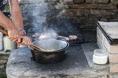 Cooking polenta on wood stove — Stock Photo