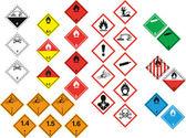 Various hazard symbols — Stock Vector