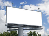 Billboard against blue cloudy sky — Stock Photo