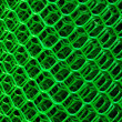 Roll of a green plastic net for a fence — Stock Photo