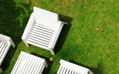 White chair on grass — Stock Photo