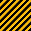 yellow and black diagonal hazard stripes painted on old brick wa — Stock Vector