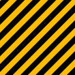 Yellow and black diagonal hazard stripes painted on old brick wa - Stock Vector