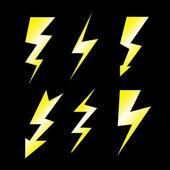Set of lightning on black — Stock Vector