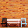 Chair in front of a brick wall — Stock Photo