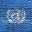 United Nations flag painted on old brick wall — Stock Photo #11950962