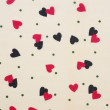 Black and red heart shaped on fabric — Stock Photo