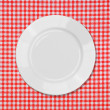 Royalty-Free Stock Photo: White plate on red and white tablecloth